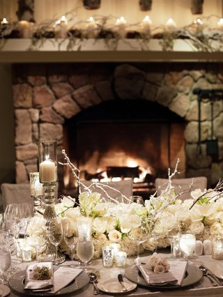 stone-fireplace-and-mantle-decorated-with-flowers
