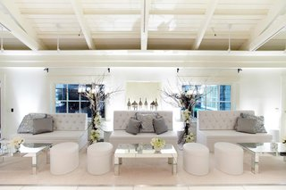 tufted-couches-and-mirrored-tabletops