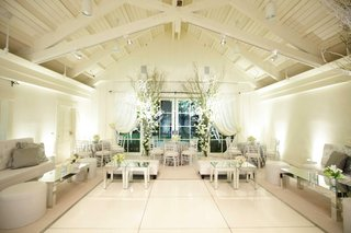 white-drapery-and-furniture-and-mirrored-tables