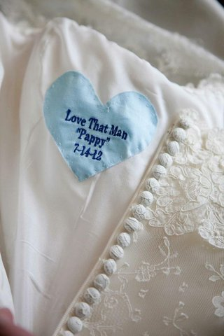 embroidered-heart-fabric-sewed-into-wedding-dress