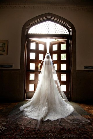 bride-in-wedding-dress-and-cathedral-veil
