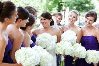 white-bridal-party-bouquets-and-purple-dresses