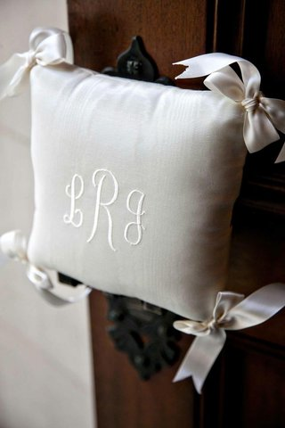 white-pillow-with-monogram-and-corner-bows