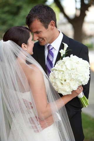 woman-holding-bouquet-that-complements-boutonneire