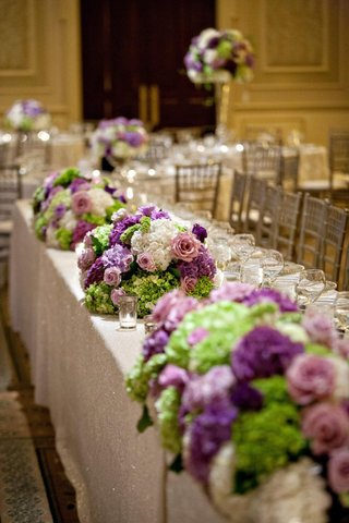 bunches-of-purple-and-green-flowers-on-tables