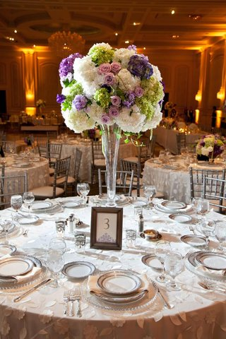 framed-table-card-and-round-flower-arrangement