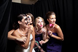 bride-with-friends-taking-photos-at-reception