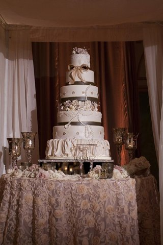 six-layer-cake-with-ruffles-ribbons-and-pearls