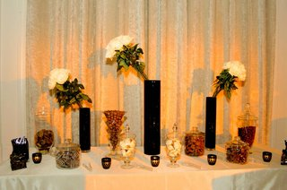 tall-black-vases-with-glass-jars-of-candy-and-chocolate