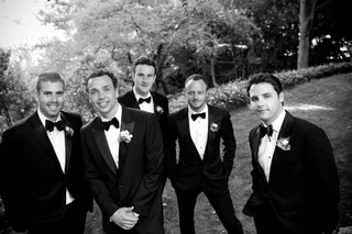 black-and-white-photo-of-men-in-tuxedos