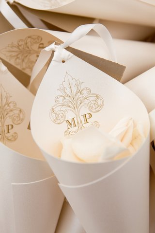 white-rose-petals-in-paper-cone-with-wedding-monogram