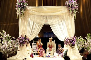indian-hindu-wedding-ceremony-with-a-white-mandap-and-purple-flowers