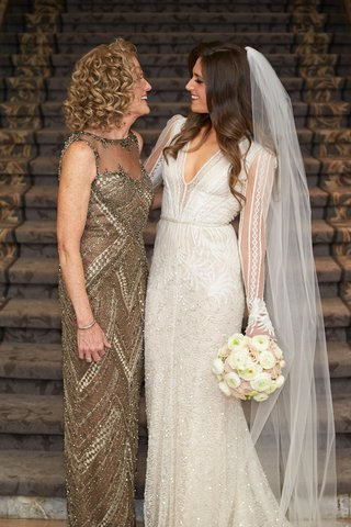 bride-in-inbal-dror-wedding-dress-long-sleeve-with-mother-of-bride-in-illusion-gold-geometric-dress