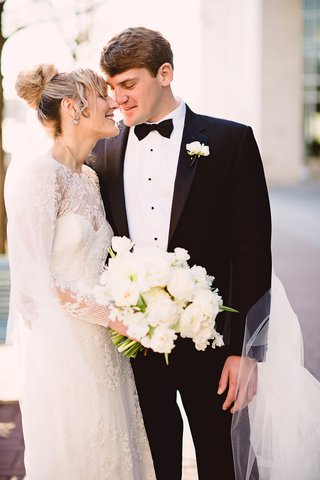 bride-in-monique-lhuillier-groom-in-jos-a-bank-closed-eyes-smile-during-first-look