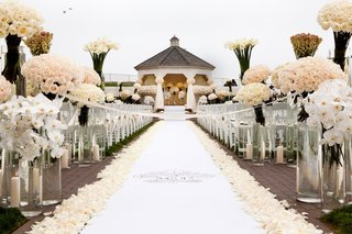 white-monogram-aisle-runner-with-tons-of-roses