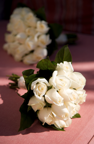 ivory-rose-nosegay-with-leaves-tied-with-ribbon