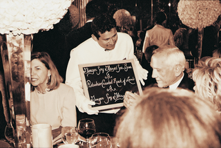 waiters-in-white-gloves-carry-chalkboard-menus