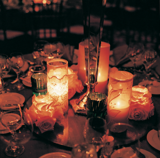 center-of-table-with-many-candles-in-various-votives