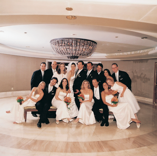 bridesmaids-in-white-dresses-and-groomsmen-in-black-suits