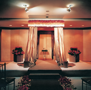 red-orange-and-cream-indoor-ceremony-decorations