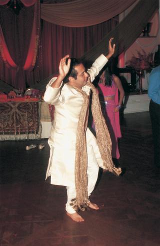 groom-dances-at-indian-wedding-reception