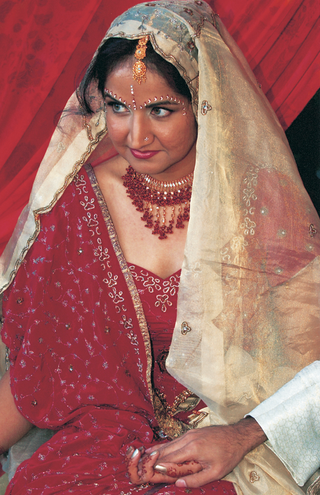 bride-in-red-dress-with-gold-veil-and-jewelry