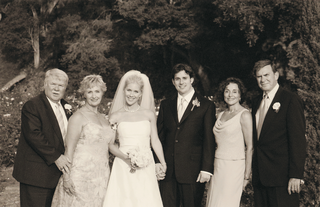 black-and-white-photo-of-newlyweds-with-their-mothers-and-fathers