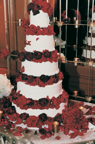 classic-white-wedding-cake-with-red-floral-tiers