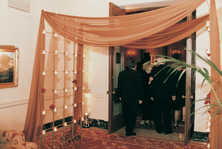 guests-walk-through-draped-grand-entrance