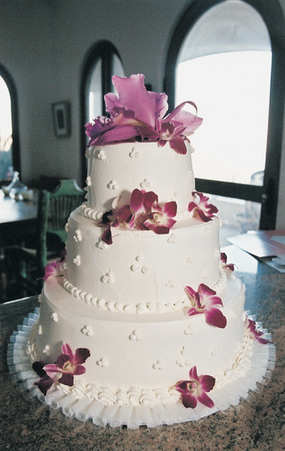 three-layer-white-wedding-confection-with-fresh-orchids