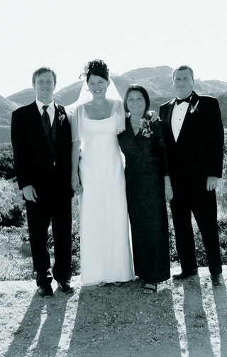 family-poses-in-malibu-with-mountains-in-background