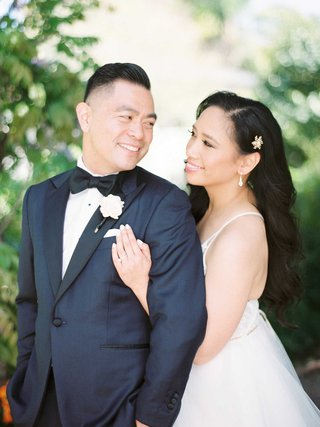bride-in-hayley-paige-wedding-dress-long-hair-headpiece-groom-in-tuxedo-bow-tie-pocket-square-flower
