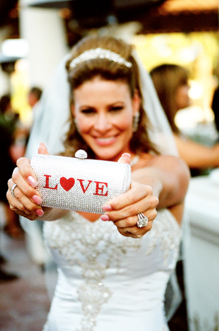 bride-holding-crystal-purse-with-red-love-sign