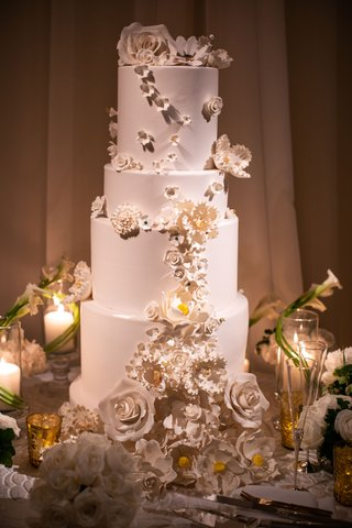 wedding reception cake with white flowers white gold wedding decor design