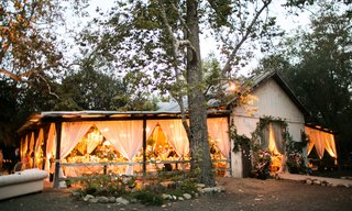 santa-barbara-dos-pueblos-ranch-in-forest-countryside-open-sides-barn-with-blush-drapery-garlands