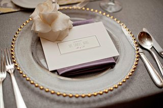 gold-rimmed-charger-plate-and-white-rose