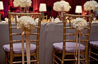 gold-chairs-with-purple-cushions-and-ivory-arrangements