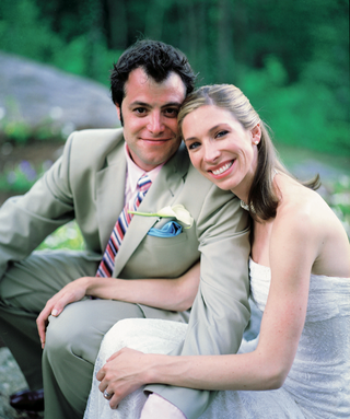 man-in-khaki-suit-and-woman-in-strapless-bridal-gown