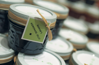 jars-of-jam-tied-with-raffia-and-green-label