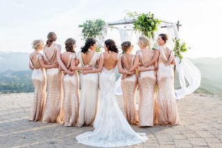 bride-in-low-back-monique-lhuillier-wedding-dress-and-bridesmaids-in-sequin-cowl-back-dresses