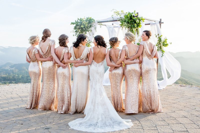 bridesmaids in gold sequin low back bridesmaid dresses white and gold wedding ideas