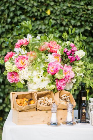outdoor-wedding-cocktail-hour-appetizer-buffet-olive-oil-tasting-pink-peony-white-flower-greenery