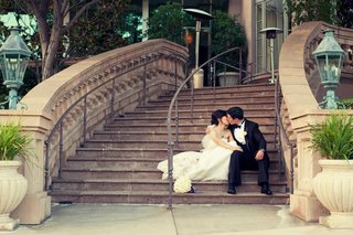 bride-and-groom-in-wedding-attire-on-steps