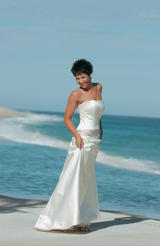 white-wedding-dress-with-ivory-sash-around-hips
