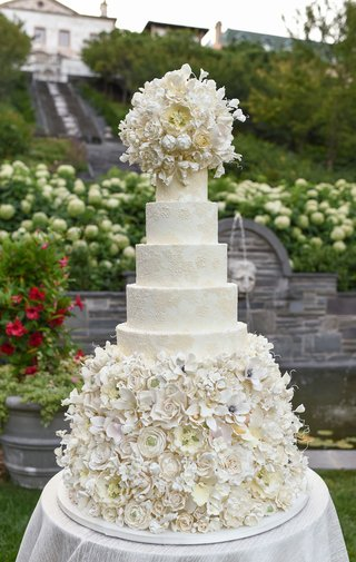 damask-wedding-cake-with-abundance-of-sugar-flowers