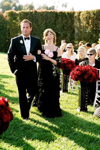 groom-walking-mother-down-aisle-in-black-dress