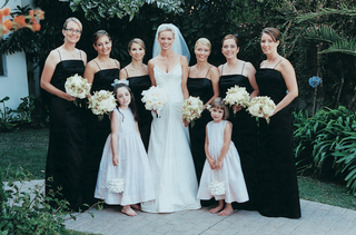 bride-poses-with-bridesmaids-and-flower-girls