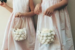 flower-girls-carry-baskets-covered-in-seashells
