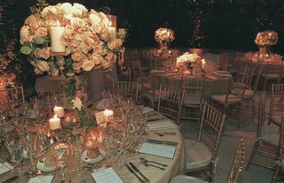 tables-featuring-tall-centerpiece-and-gold-linens