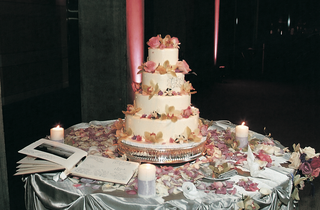 cake-with-ivory-frosting-and-colorful-flowers
